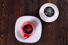 Cake with berries with fresh coffee. Old dark table Stock Photos