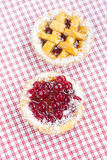 Cake with berries on plaid fabric Stock Photos