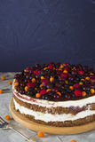 Cake with berries raspberry and black current on grey table Stock Photo