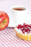 Cake with berries and tea on plaid fabric Royalty Free Stock Images