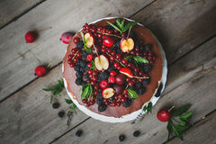 Cake with berries on wooden background Stock Photos