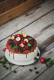 Cake with berries on wooden background Royalty Free Stock Photo