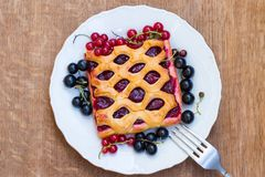 Cake with berry jam is served with fresh  red and black currant Stock Images