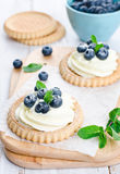 Cake with bilberries. Bilberry pie on a wooden table Stock Photos