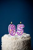 Cake: Birthday Cake With Candles For 65th Birthday Royalty Free Stock Photo