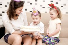 Cake for birthday of child. Mom holds birthday cake for children`s birthday. stock photo