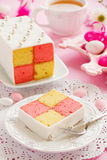 Cake biscuit Battenberg with marzipan. Royalty Free Stock Photography