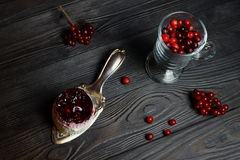 Cake from biscuit dough with berry filling and coconut. Delicious cake from biscuit dough with berry filling and coconut on the blade for cake and cranberries in Royalty Free Stock Image