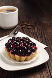 Cake with black currants and coffee cup Royalty Free Stock Photos