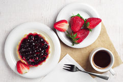 Cake with black currants, strawberry and coffee Royalty Free Stock Image