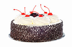 Cake Black Forest with whipped cream, candied cherry and chocola Stock Images