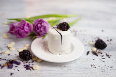 Cake with blackberry and tulip, Valentines Day background. Selective focus Royalty Free Stock Images