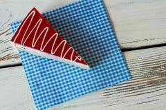 Cake on blue checkered napkin. Royalty Free Stock Photo