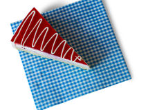 Cake on blue checkered napkin. Royalty Free Stock Images