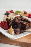 Cake with blueberries and frangipane, garnished with fruits Stock Photos
