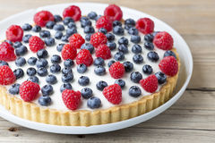 Cake with blueberries and raspberries. Confectionery product. Stock Images