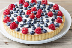 Cake with blueberries and raspberries. Confectionery product. Stock Photography