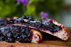 Cake with blueberry. Part a piece of cake with blueberry closeup Royalty Free Stock Image