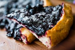 Cake with blueberry. Part a piece of cake with blueberry closeup Royalty Free Stock Photography
