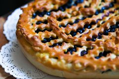 Cake with blueberry. Blueberry cake with blueberry on table closeup Stock Photography