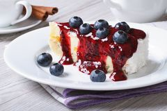 Cake with blueberry, berry sauce on plate and coffee Stock Image