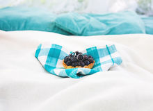 Cake with blueberry on blue napkin Royalty Free Stock Photography