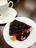 Cake blueberry with coffee cup in background Royalty Free Stock Photos