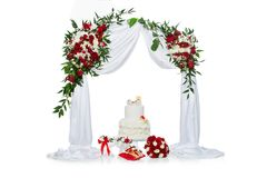 Cake with bone for dog wedding. Beautiful traditional white wedding cake with bone decor for dog wedding party standing under flower archway. studio shot. copy stock photography