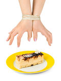 Cake and bound hands Stock Photography
