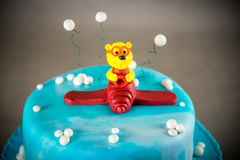 Cake for boy`s birthday. Blue kids birthday cake decorated with plane toy on grey background Royalty Free Stock Photos
