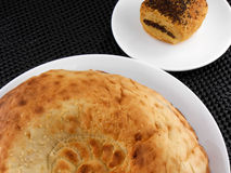 Cake and bread on white plate Stock Photography