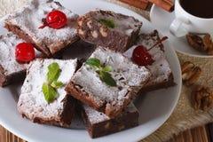 Cake brownie with walnuts and coffee. Horizontal closeup Royalty Free Stock Photo