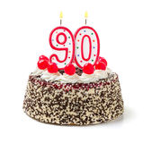 Cake with burning candle number 90 royalty free stock image