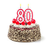 Cake with burning candle number 80 Royalty Free Stock Image