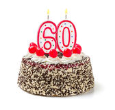 Cake with burning candle number 60 Royalty Free Stock Images