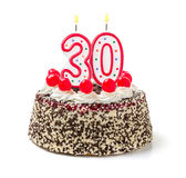 Cake with burning candle number 30. Birthday cake with burning candle number 30 Stock Photos