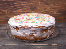 Cake candied fruit and sugar powder Royalty Free Stock Photos