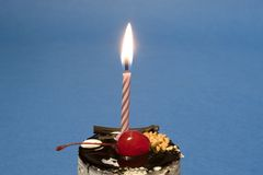Cake and Candle. Chocolate cake with candle on blue background. Dessert series Stock Photography