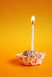 Cake with candle. Cake with colored cup with a candle Royalty Free Stock Photography