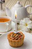 Cake with a candle Royalty Free Stock Photos