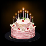 Cake with candles. On a dark background Royalty Free Stock Image