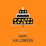 Cake with candy corn, pumpkin, ghost and candle. Happy Halloween. Black background. Flat design Stock Photo