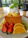 Cake. Candy, orange, strawberry, kiwi stock image