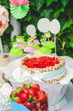 Cake, candy, sweets and strawberries on a festive table Stock Photography