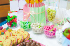 Cake, candy, sweets and strawberries on a festive table Royalty Free Stock Photo