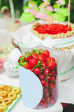 Cake, candy, sweets and strawberries on a festive table Stock Images