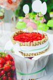 Cake, candy, sweets and strawberries on a festive table Stock Photos
