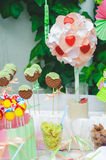 Cake, candy, sweets and strawberries on a festive table Royalty Free Stock Photography