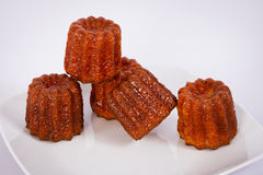 Cake canneles from France. On a white plate stock photography