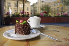 Cake and cappuccino stock image